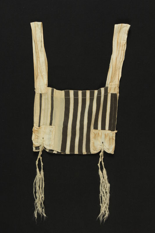 2003.163.1 front Black and white striped wool tallit katan found postwar by a Polish Jewish man