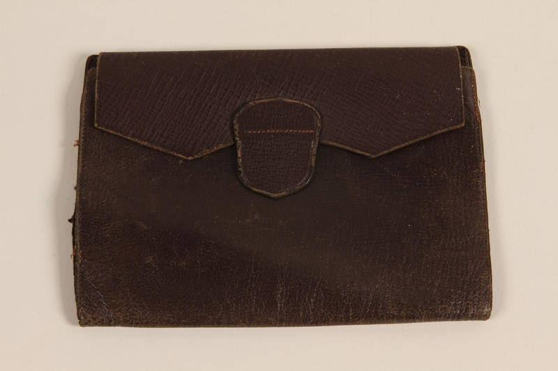 2003.160.2 front Brown leather trifold wallet used by a Jewish medical officer, 2nd Polish Corps