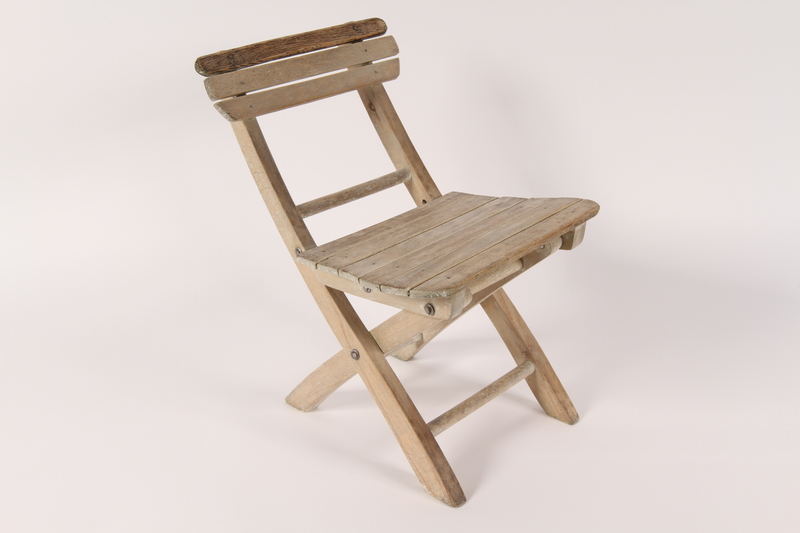 2003.164.2 3/4 view right Folding chair used by hidden child