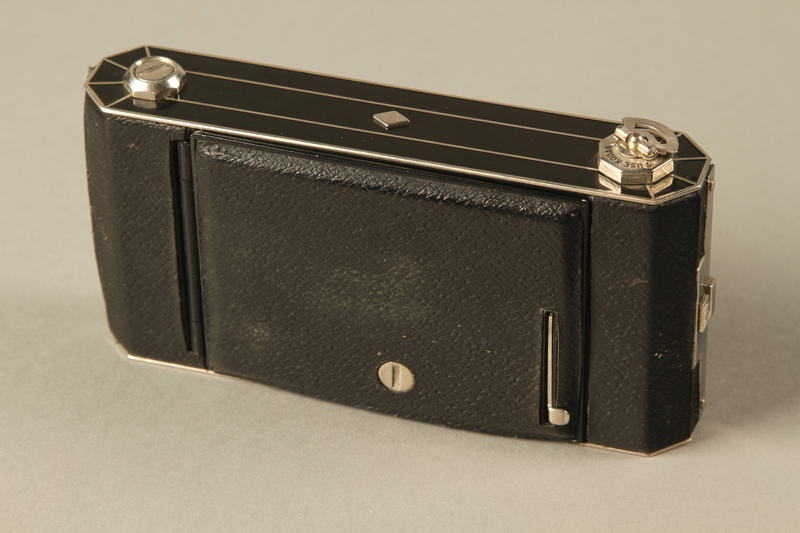 2000.526.2 a closed Six-20 Kodak camera and accessories used by US soldier