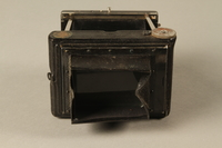 2000.526.3 a back Goerz Tenax pocket camera and accessories used by US soldier  Click to enlarge