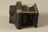 2000.526.3 a right Goerz Tenax pocket camera and accessories used by US soldier  Click to enlarge