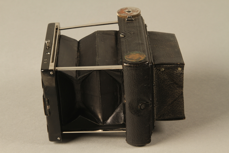 2000.526.3 a left Goerz Tenax pocket camera and accessories used by US soldier