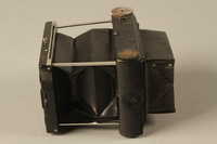 2000.526.3 a left Goerz Tenax pocket camera and accessories used by US soldier  Click to enlarge
