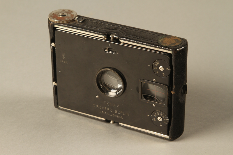 2000.526.3 a closed Goerz Tenax pocket camera and accessories used by US soldier