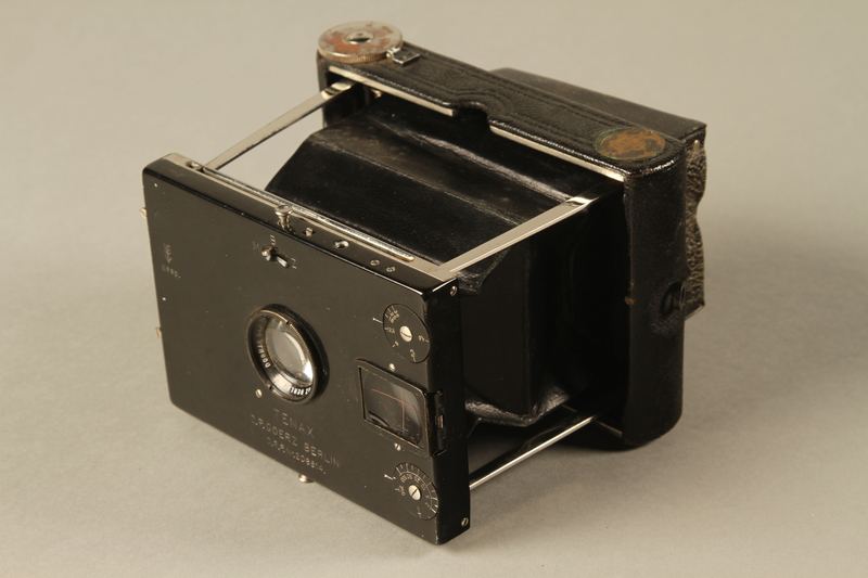 2000.526.3 a 3/4 view Goerz Tenax pocket camera and accessories used by US soldier