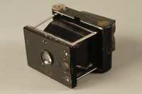 2000.526.3 a 3/4 view Goerz Tenax pocket camera and accessories used by US soldier  Click to enlarge