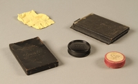 2000.526.3 c-g 3/4 view Goerz Tenax pocket camera and accessories used by US soldier  Click to enlarge