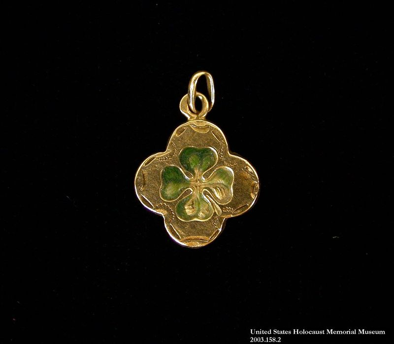 2003.158 front Gold 4-leaf clover charm buried and recovered postwar by a Hungarian Jewish girl