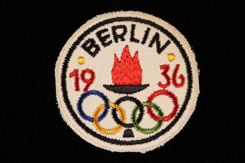 2000.527.1 front Badge for the 1936 Berlin Olympics