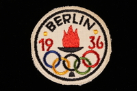 2000.527.1 front Badge for the 1936 Berlin Olympics  Click to enlarge