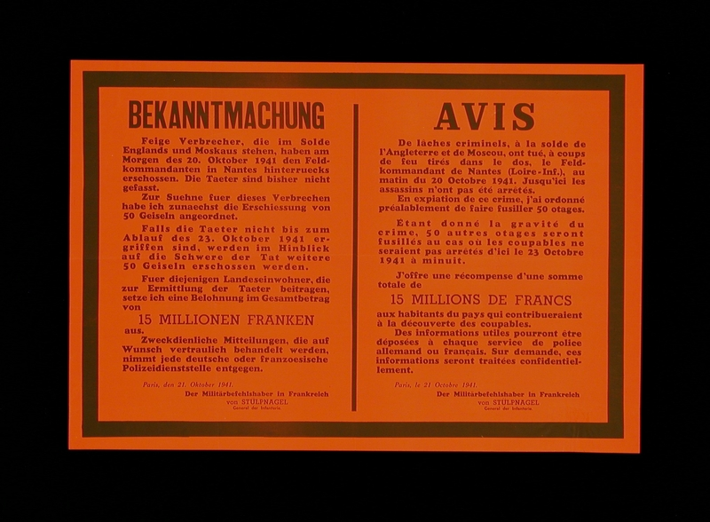 2003.189.6 front Text only red poster announcing the execution of French hostages after the assassination of a German officer