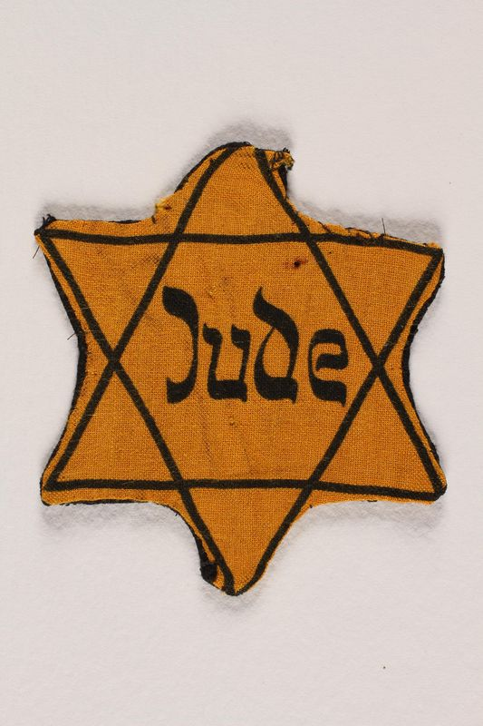 1988.64.1.3 front Star of David badge with Jude printed in the center