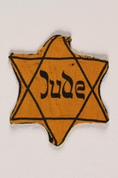 1988.64.1.3 front Star of David badge with Jude printed in the center  Click to enlarge