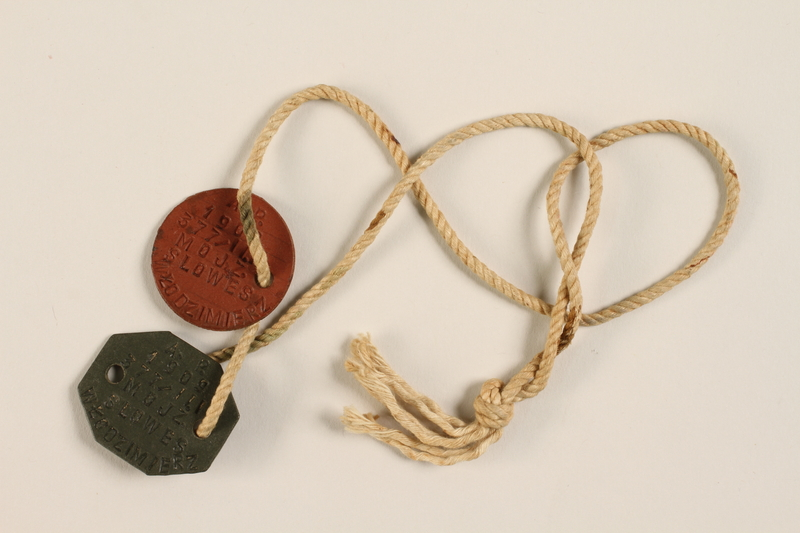 2002.477.2 front Two military ID tags on a cord worn by a Jewish medical officer, 2nd Polish Corps