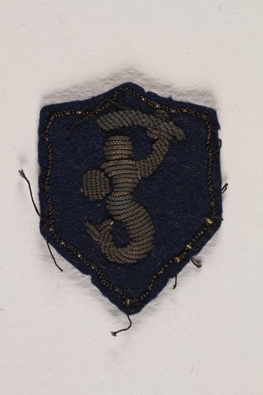 2002.477.4 front 2nd Polish Corps Syrenka patch with the Warsaw Mermaid worn by a Jewish medical officer, 2nd Polish Corps