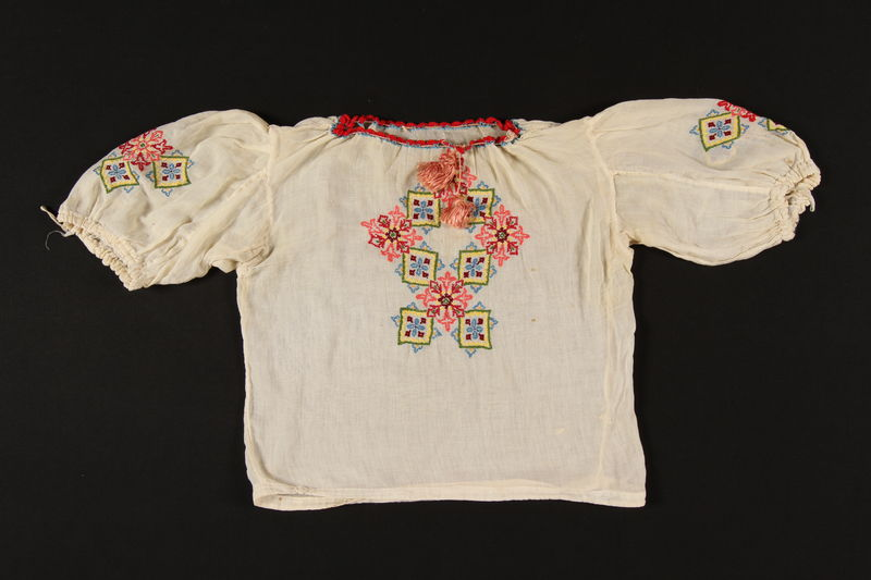 2003.193.2 front Embroidered floral smock worn by a Jewish girl in prewar Poland
