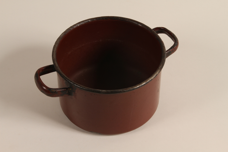 2003.193.3 a front Enameled Dutch oven used by a Jewish family in a displaced persons camp