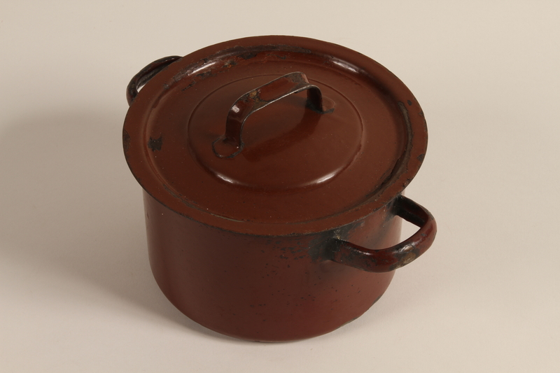 2003.193.3 a-b front Enameled Dutch oven used by a Jewish family in a displaced persons camp