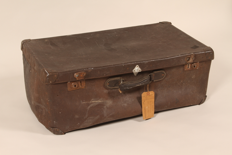 2003.198.1 front Large brown suitcase used by Hungarian Jewish refugees on the Kasztner train