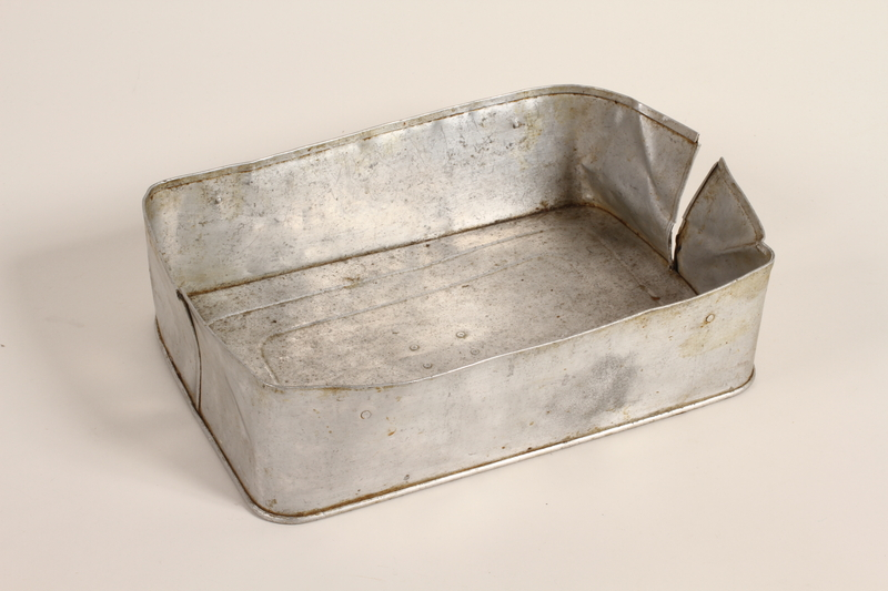2003.198.3 front Aluminum food container lid used by a Hungarian Jewish family on the Kasztner train