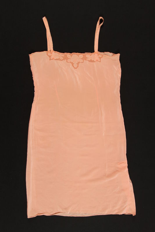2003.198.4 front Peach chemise with floral embroidery saved by a Hungarian Jewish refugee