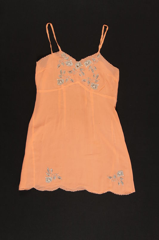 2003.198.5 front Peach chemise with black and white floral appliques saved by a Hungarian Jewish refugee
