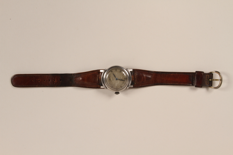 2003.198.7 front Omega wristwatch worn by a Hungarian Jewish man on the Kasztner train