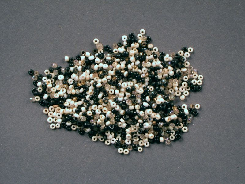 2003.155.3 front Small black, white, gold, and clear glass beads used by a Dutch Jewish girl in hiding