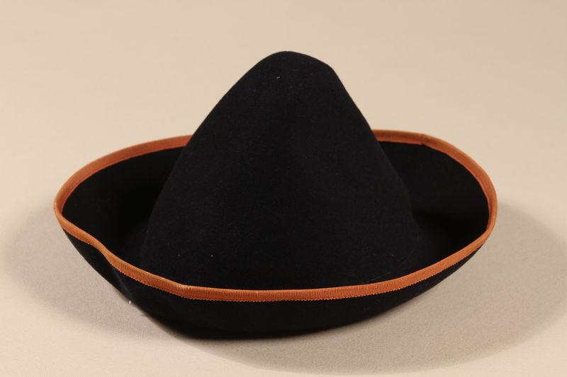 2003.215.1 front Blue felt hat worn by a German Jewish girl on the Kindertransport
