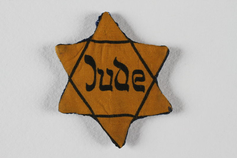 1988.140.4 front Star of David badge with Jude given to a US liberator by an inmate