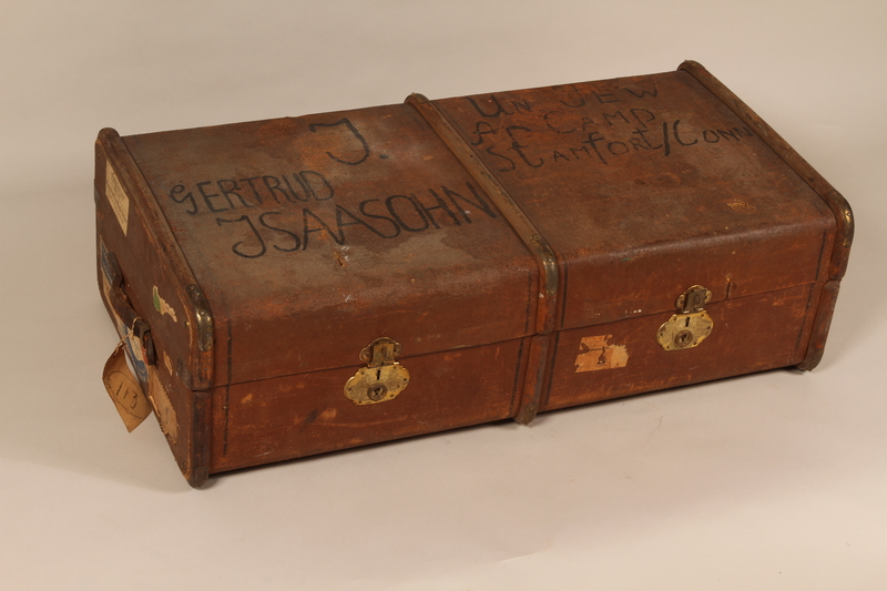 2003.242.2 front Brown burlap covered trunk used postwar by a young German Jewish refugee