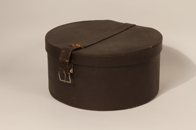 2003.242.4 closed Imitation leather hatbox used postwar by a young German Jewish refugee