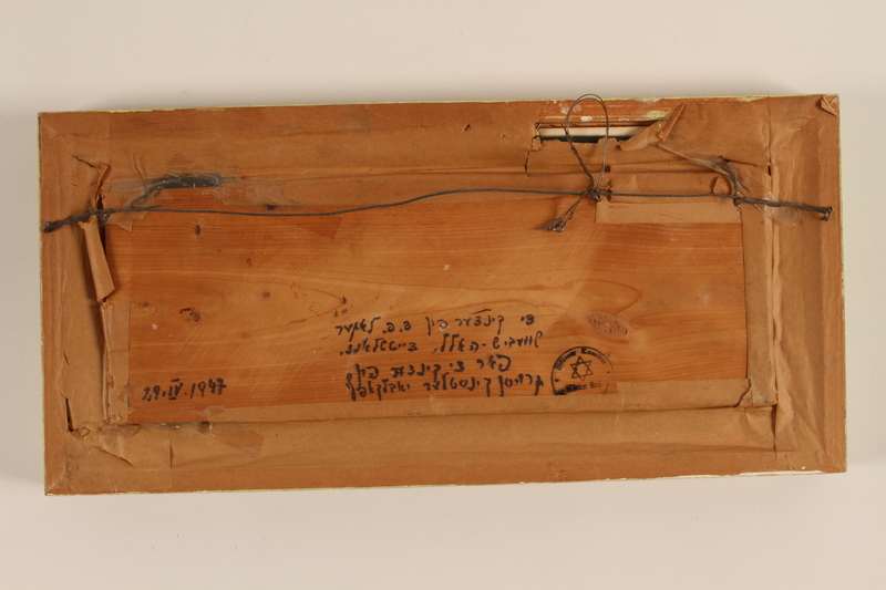1989.58.147 back Handcrafted wooden picture given to a Yiddish entertainer at a displaced persons camp