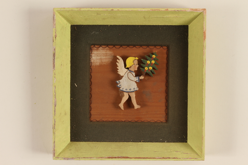 1989.58.148 front Handcrafted wooden picture given to a Yiddish entertainer at a displaced persons camp