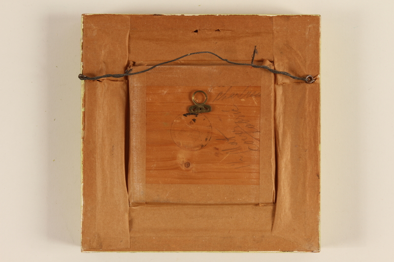 1989.58.148 back Handcrafted wooden picture given to a Yiddish entertainer at a displaced persons camp