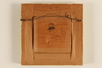 1989.58.148 back Handcrafted wooden picture given to a Yiddish entertainer at a displaced persons camp  Click to enlarge