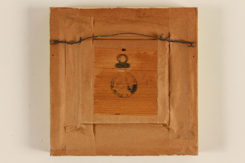 1989.58.149 back Handcrafted wooden picture given to a Yiddish entertainer at a displaced persons camp