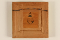 1989.58.149 back Handcrafted wooden picture given to a Yiddish entertainer at a displaced persons camp  Click to enlarge