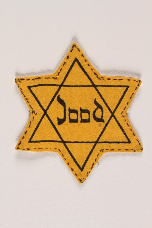 1988.118.1 front Star of David badge printed with Jood to identify a Dutch Jew