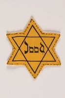 1988.118.1 front Star of David badge printed with Jood to identify a Dutch Jew  Click to enlarge