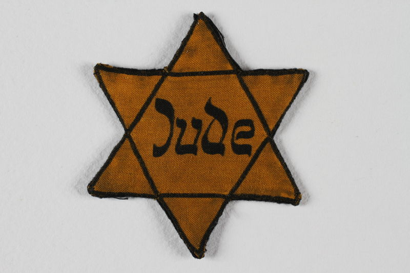1989.208.3 front Yellow cloth Star of David badge printed with the word Jude