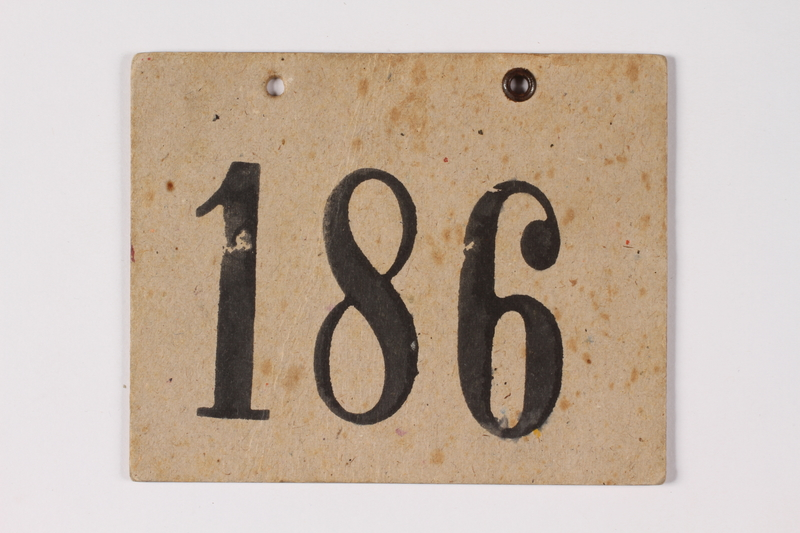 1989.215.2 front Numbered ID sign issued to a Jewish Austrian boy for the Kindertransport