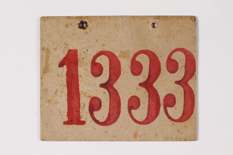 1989.215.2 back Numbered ID sign issued to a Jewish Austrian boy for the Kindertransport