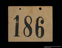 1989.215.2 front Numbered ID sign issued to a Jewish Austrian boy for the Kindertransport  Click to enlarge