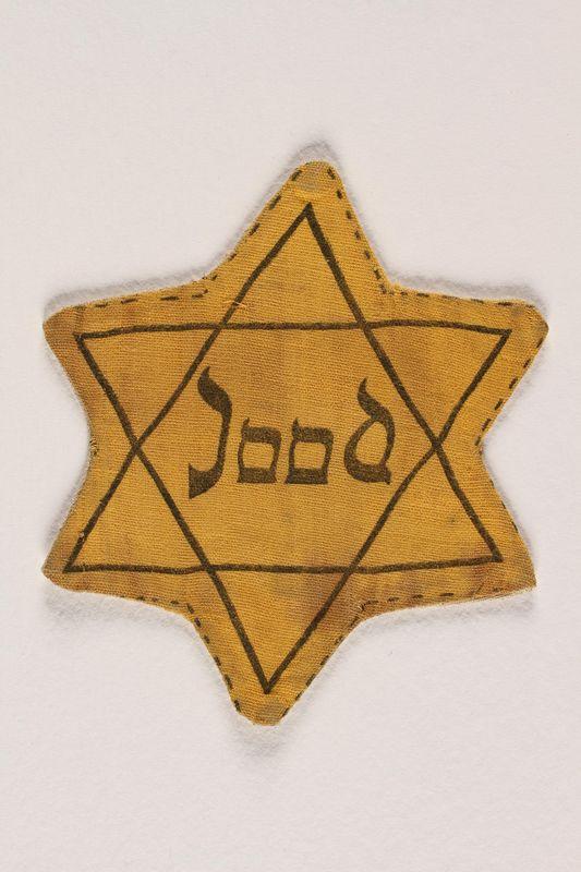 1989.251.8 front Star of David badge printed Jood worn by German Jewish boy