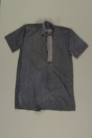 2003.294.2 front White striped blue shirt worn by Polish Jewish slave laborer  Click to enlarge