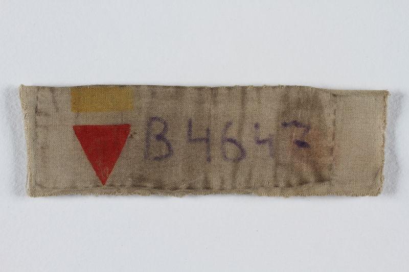 2003.294.3 front Prisoner ID badge B 4647 worn by Polish Jewish slave laborer