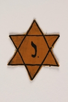 2003.348.2 front Yellow Star of David badge with the letter J worn by a Belgian Jewish boy  Click to enlarge