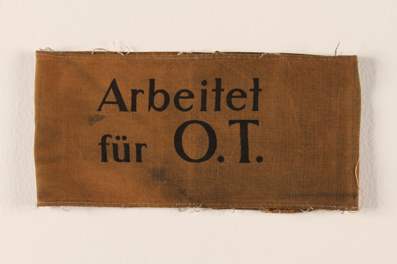 1989.298.1 front Armband to identify a worker